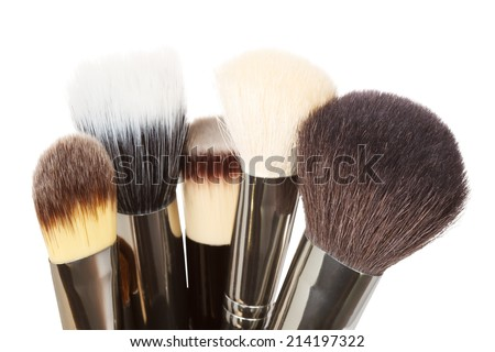 Close-up of makeup brushes isolated on a white background - stock photo