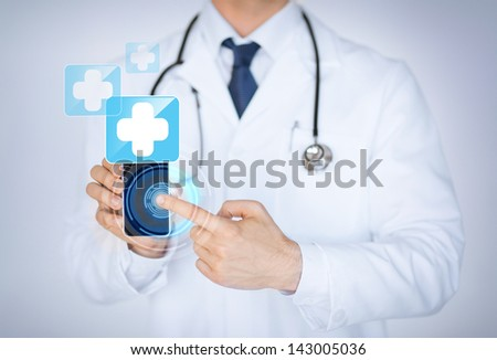 close up of male doctor holding smartphone with medical app - stock photo