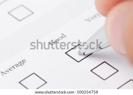 Close up of male hand filling out the questionnaire