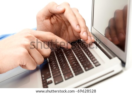 Close-up of male hand over laptop keyboard while the other one hiding forefinger - stock photo