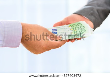 Close up of male hands accepting money.
