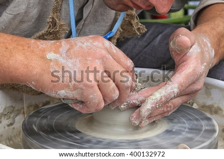 close-up of male hands of the potter during the manufacture of clay pot