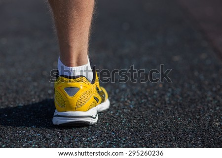 Close up of male leg in sneaker. The sportsman is ready to run. There is copy space in right side - stock photo