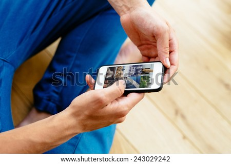 Close-up of man browsing social media on smartphone - stock photo