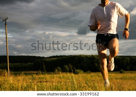 Close-up of man doing exercise at autumn - stock photo