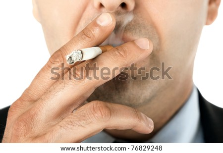 Close-up of man face holding cigarette and smoking - stock photo