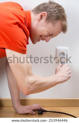 Close-up of man fixing socket being electrocuted - stock photo
