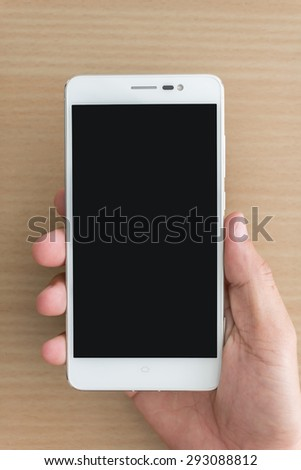 Close up of man hand holding smartphone - stock photo
