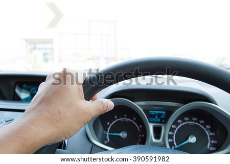 Close-up of man hand holding steering wheel-2