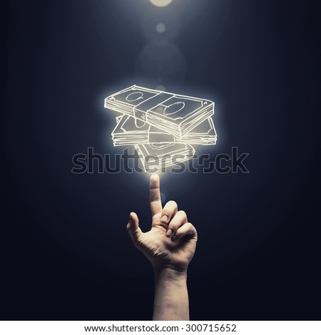 Close up of man hand pointing at money symbol - stock photo