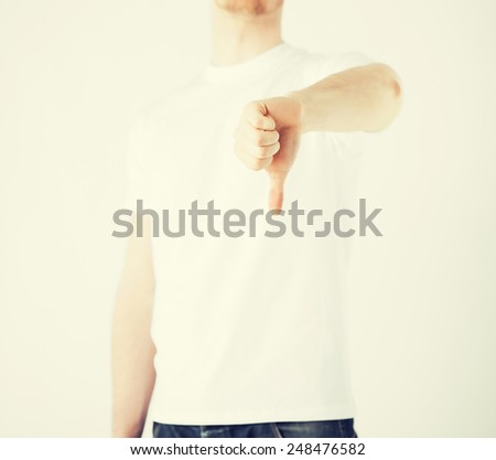 close up of man hand showing thumbs down - stock photo