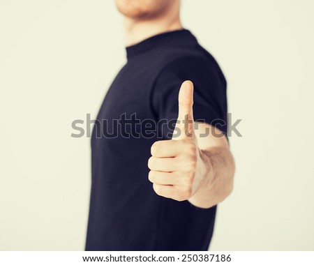 close up of man hand showing thumbs up