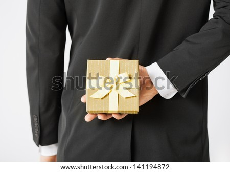 close up of man hands holding gift box - stock photo