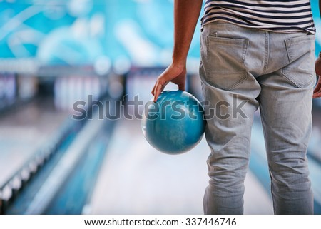 Close-up of man holding a bowling ball