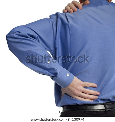close-up of man in blue shirt with sore aching back - stock photo