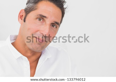Close up of man looking at camera on the white background