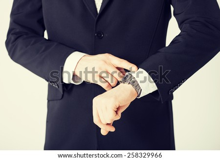 close up of man looking at wristwatch
