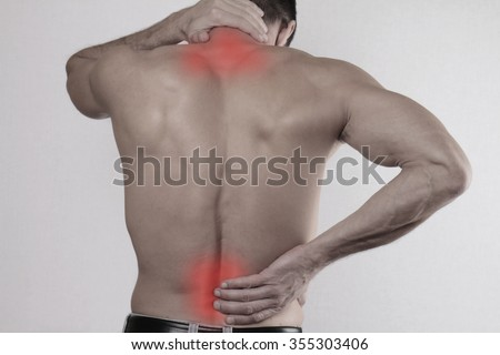 Close up of man rubbing his painful back. Pain relief,  chiropractic concept - stock photo