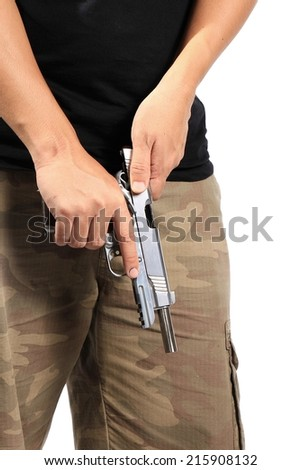 Close up of man's hand reloading gun, Man hold and loading ammunition his pistol on white background. Army, Semi-automatic handgun, 45 pistol.