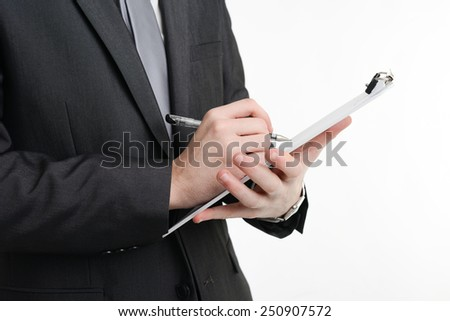 close up of man's hand writing on a notepad  - stock photo