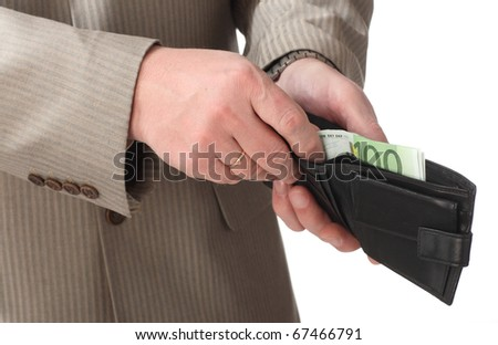 Close-up of man's hands putting euro banknotes into the wallet isolated on white - stock photo