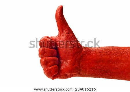 Close Up Of Man's Red Hand Giving Thumbs Up - stock photo