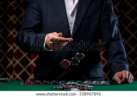 Close-Up of Man Throwing a Poker Chips