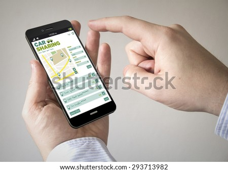 Close up of man using 3d generated mobile smart phone with car sharing app on the screen. Screen graphics are made up. - stock photo