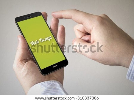 Close up of man using 3d generated mobile smart phone with web design on the screen. Screen graphics are made up.