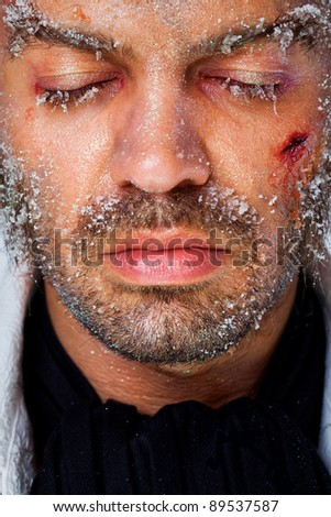 Close-up of man with closed eyes and frost make-up on face