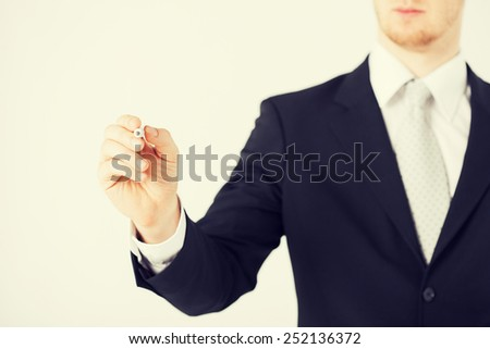 close up of man writing something in the air - stock photo