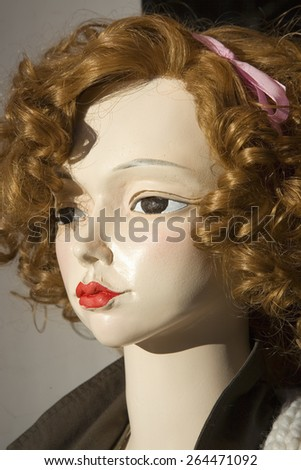 Close up of mannequin woman with red hair and red lipstick, Barcelona, Spain