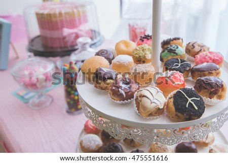 close up of many small colorful doughnut in birthday party