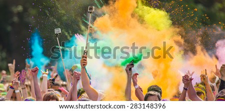 Close-up of marathon, people covered with colored powder. - stock photo