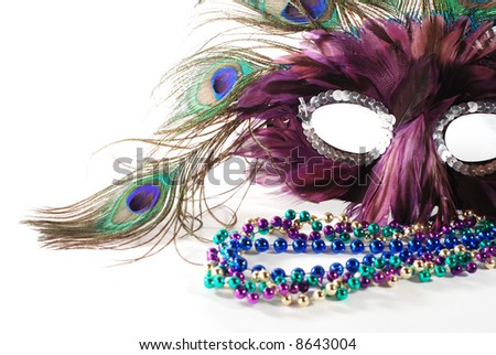 close-up of Mardi Gras mask and beads - stock photo