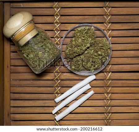 close up of marijuana on bamboo  - stock photo