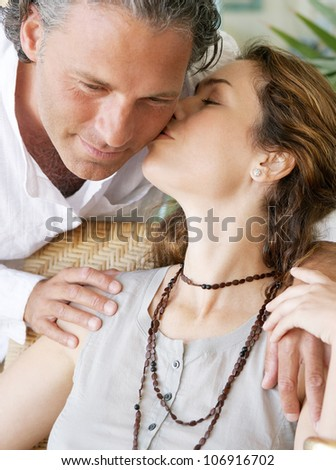 Close up of mature couple kissing. - stock photo