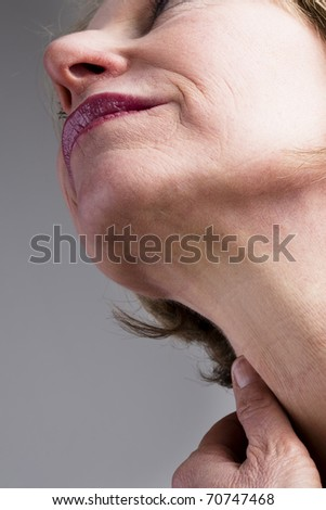 Close-up of mature woman neck - stock photo