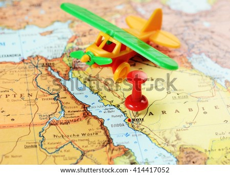 Close up of  Mecca,Saudi Arabia   map with red pin and airplane toy  - travel concept