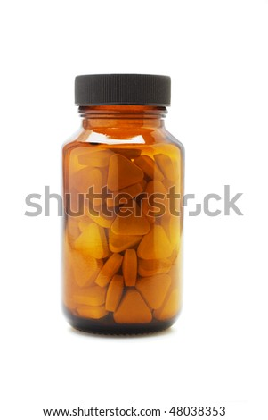 close up of medicine bottle with triangular shape tablets inside on white - stock photo