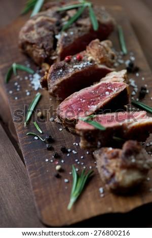 Close-up of medium rare grilled ribeye beef steak, studio shot - stock photo