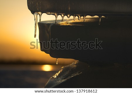 Close-up of melting transparent ice on a spring day - stock photo