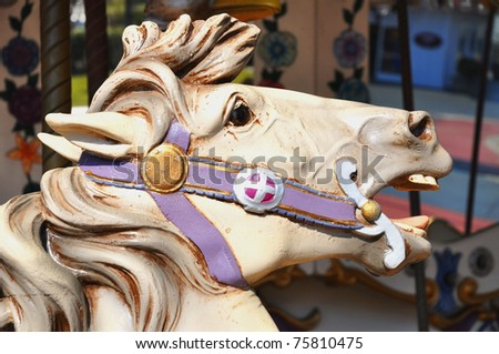 Close up of Merry go round carousel horse - stock photo