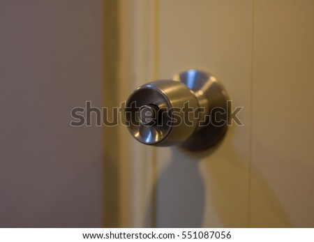 close up of metal handle on a wooden door,golden door knob.