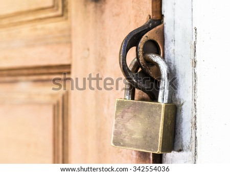 Close up of  metal lock to wooden door for security protection - stock photo