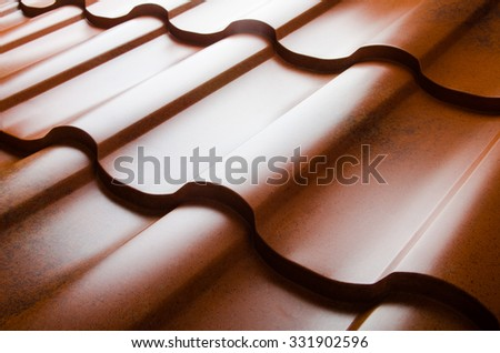 Close up of metal roof tile - stock photo