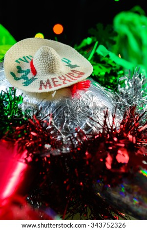 Close up of Mexican pinata with mexican hat - stock photo