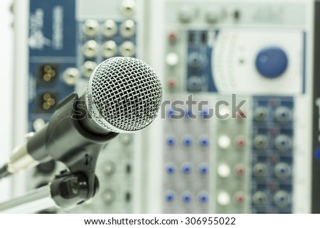Close up of microphone in concert hall or conference room, Close up old microphone in conference room , Studio equipment. - stock photo