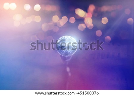 Close up of microphone in concert hall or conference room on abstract blurred background