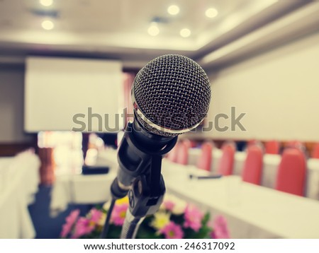 Close up of microphone in  conference room with de-focused bokeh lights in background. Extremely shallow dof. : vintage style. - stock photo